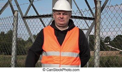 Worker showing stop gesture