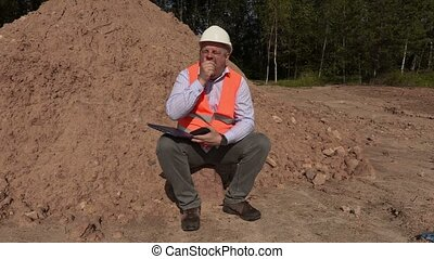 Worker sitting and yawns