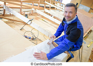worker sitting on a frame