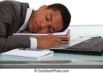 Worker sleeping on his desk