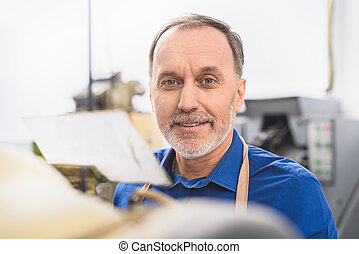 worker smiling while looking at the camera
