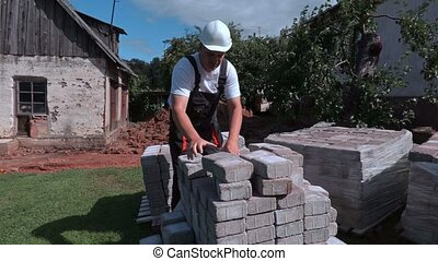 Worker sorting bricks