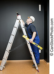 worker standing on a ladder
