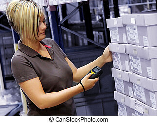 worker scans pallets and boxes in the warehouse