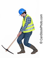 Worker struggling to lift axe
