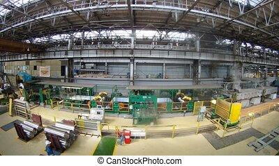 Worker supervises production in plant shop, time lapse