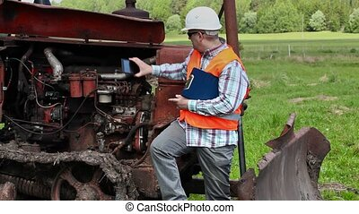 Worker take picture of diesel engine