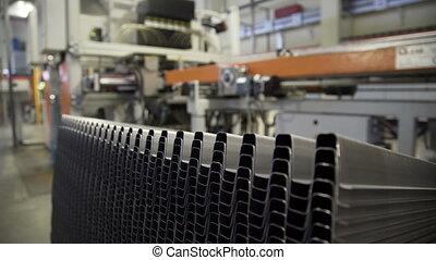 Worker taking Bending aluminium sheet at metallurgical plant...