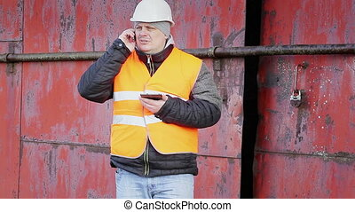 Worker talking on cell phone near