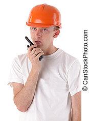 worker talking on portable UHF radio transceiver