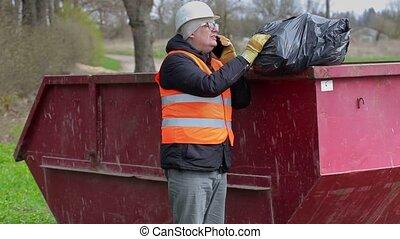 Worker talking on smart phone