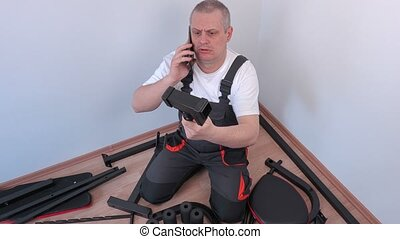 Worker talking on smart phone near exercise machine...