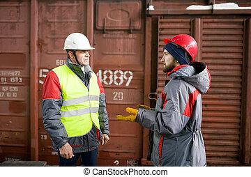 Worker Talking to Supervisor in Docks