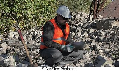 Worker throw bricks
