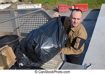Worker tipping refuse sacks