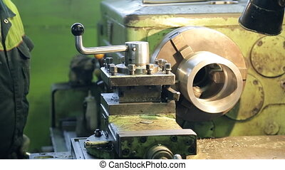 Worker triggers mechanism on factory, engineering industry....