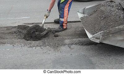 worker truck load asphalt