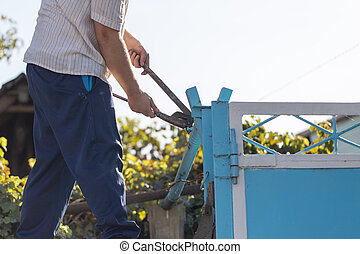 Worker twists pipe wrench