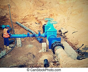 Worker underground for reconstrucion of drink water system....
