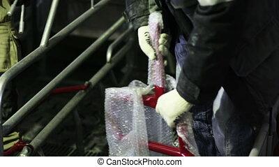worker unpacks detail fence - worker in white gloves unpacks...
