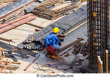Worker use electric industrial steel cutting machine work in area construction building.