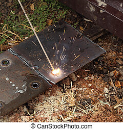 worker use electric welding for cutting hole and drill metal...