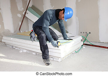 Worker using a measuring tape