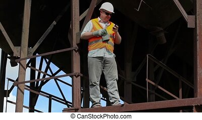 Worker using cell phone
