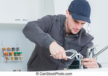 Worker using crimping tool
