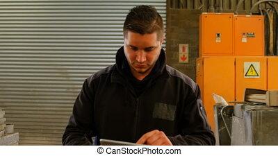 Worker using digital tablet in foundry workshop 4k - Worker ...