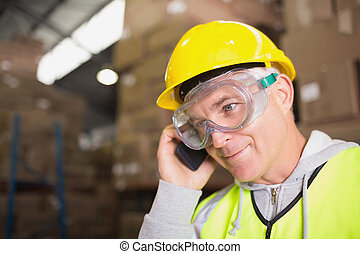 Worker using mobile phone