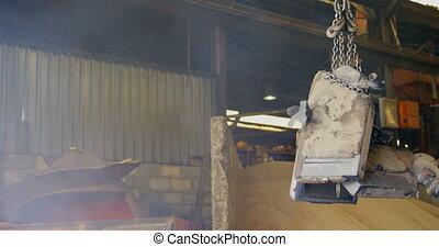 Worker using overhead crane in workshop 4k - Worker using ...