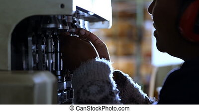 Worker using rope making machine 4k - Close-up of worker ...