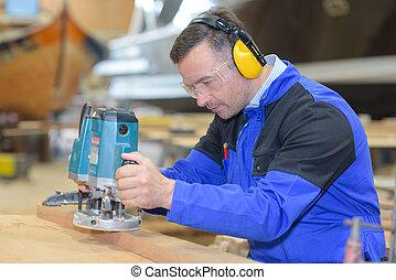 Worker using sander