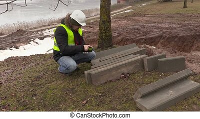 Worker using tablet PC and numbering