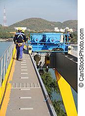 worker walking on big crane