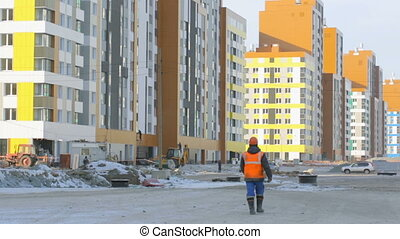 Worker walking to the construction site