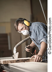 Worker wearing a safety mask