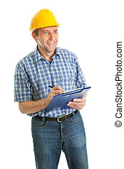 Worker wearing hard hat and taking notes