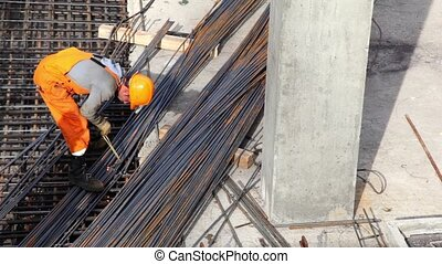 Worker weld metal gratings by acetylene torch