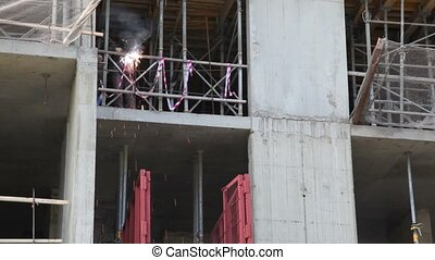 Worker weld metal railing by acetylene torch