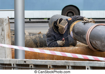 Worker welding gas line
