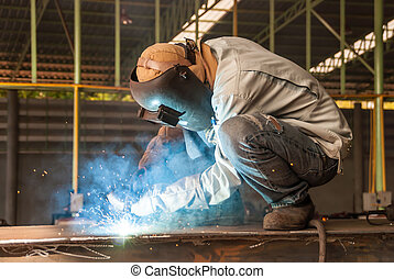 worker welding in factory