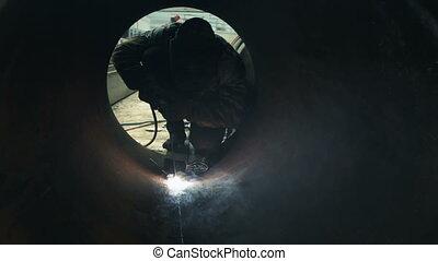 worker welding metal piping stock video