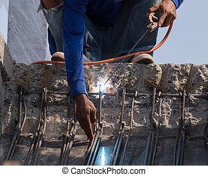 worker welding steel metal
