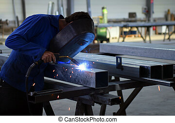 Worker welding