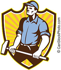 Illustration of a union worker with sledgehammer hammer done in retro style set inside shield crest with sunburst on isolated white background.