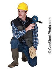 Worker with a brick and grinder