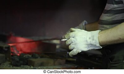 worker with a cigarette in his hand