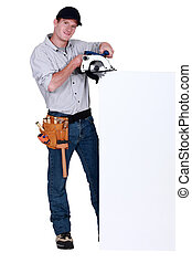 Worker with a circular saw and blank board